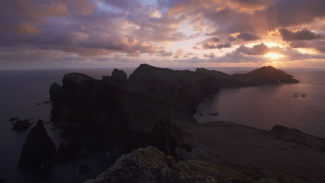 time lapse of sunrise at the sao lourenco peninsula. high cliffs and multiple sea stacks make this narrow cape an interesting destination to explore. - peninsula stock videos and b-roll footage