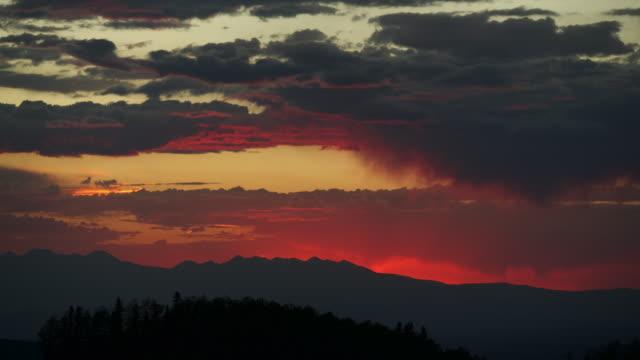 time lapse of sunrise behind mountain range - mountain range stock videos & royalty-free footage