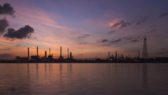 time lapse of sunrise morning sky over oil refinery factory - oil rig supply ship stock videos and b-roll footage