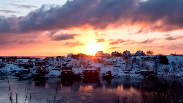 Time lapse of sunrise over fishing village in coastline at morning on winter season
