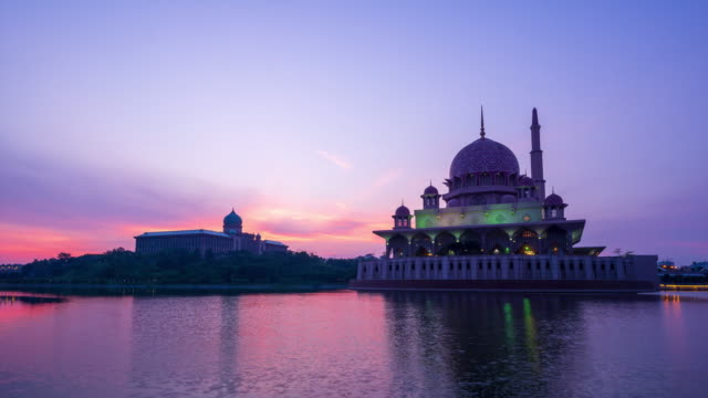 4k time lapse of sunrise over putra mosque in putrajaya, malaysia. - putrajaya stock videos & royalty-free footage