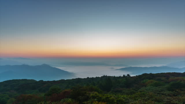 time lapse of sunrise over sea of clouds - pyeongchang stock videos and b-roll footage