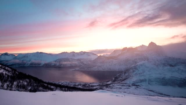 time lapse of sunrise over snow hill with blizzard in arctic ocean at morning - steep stock videos & royalty-free footage