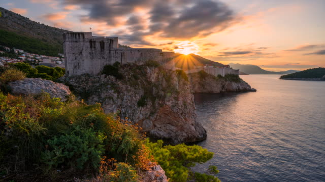 time lapse of sunrise scene of fort near by sea and old city of dubrovnik, croatia - cathedral stock videos & royalty-free footage