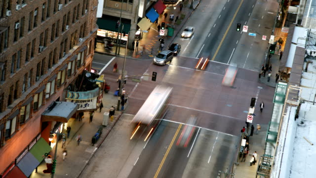 time lapse of sunset at busy intersection - pedestrian stock videos & royalty-free footage