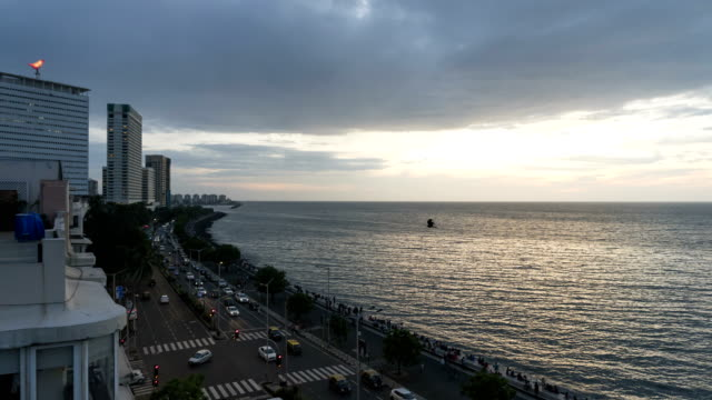 time lapse of sunset in mumbai city - marine drive - famous place stock videos & royalty-free footage