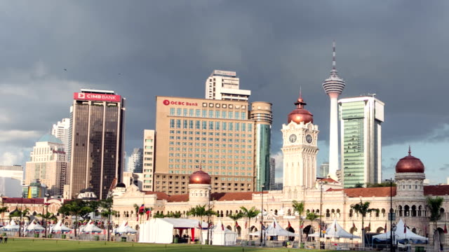 time lapse of sunset over kuala lumpur - sultan abdul samad building stock videos & royalty-free footage