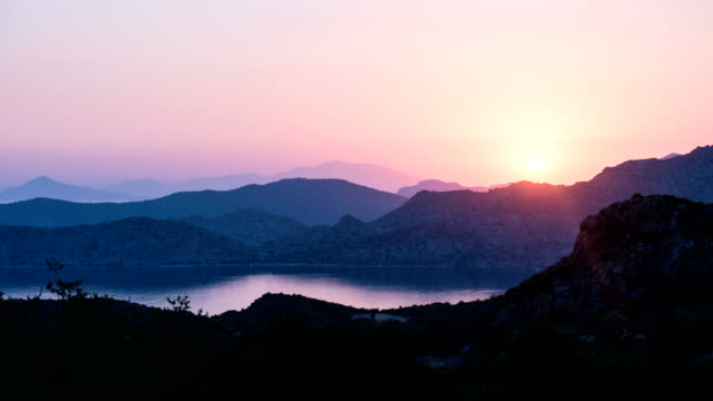 time lapse of sunset view of mountains and sea - greek islands stock videos and b-roll footage