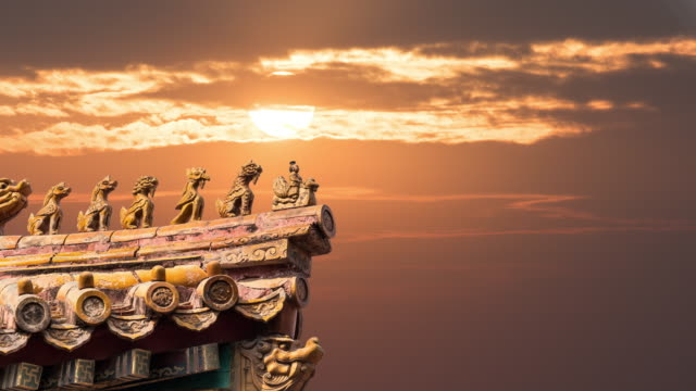 4k time lapse of sunset with clouds and ancient buildings in the forbidden city, beijing, china - forbidden city stock videos & royalty-free footage