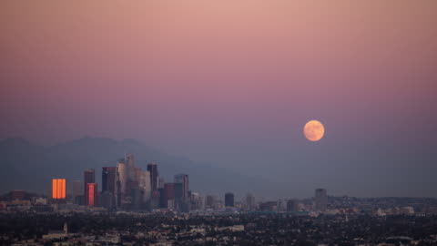 time lapse of supermoon rising over city of los angeles - los angeles county stock videos & royalty-free footage