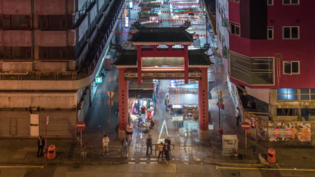 time lapse of temple street night market - temple street market stock videos and b-roll footage