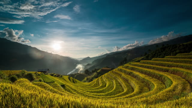 4k time lapse of terraced rice field when sunset with undefined vietnamese hmong walking and working at mu cang chai - sa pa stock videos and b-roll footage