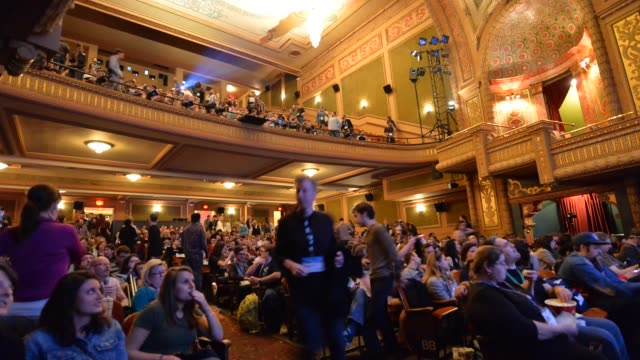 "time lapse of the audience entering the screening of ""grand budapest hotel"" during the 2014 sxsw music, film + interactive festival at the paramount... - audience stock videos & royalty-free footage"