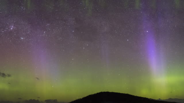 time lapse of the aurora australis or southern lights, close up view, very active display with beams and picket fence formation, tasmania. - aurora australis stock videos & royalty-free footage