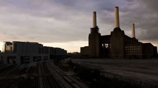london - circa 2012:  time lapse of the battersea power station in london circa 2012. - battersea stock videos & royalty-free footage
