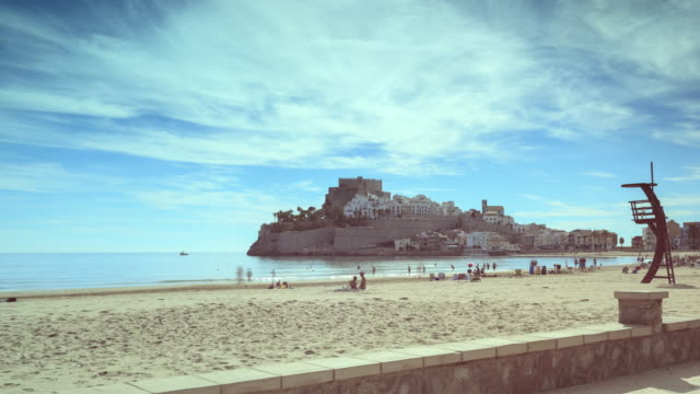 time lapse of the beach and the castle in the city of peniscola - lifeguard chair stock videos & royalty-free footage
