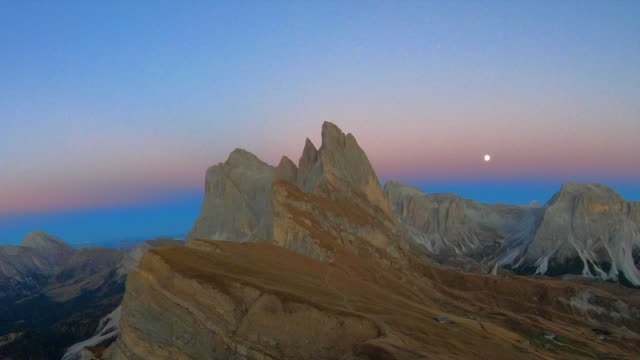 Time lapse of the beautiful Dolomites mountains on the top of the Seceda mountains at dusk.
