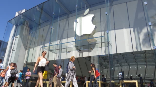 time lapse of the beautiful flagship apple store in santa monica california with many customers entering and exiting the modern glass structure - flagship store stock videos and b-roll footage