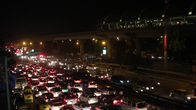 time lapse of the busy traffic at the chhatarpur crossing at seen from the foot bridge at the chhatarpur metro station in new delhi, india - delhi stock videos & royalty-free footage