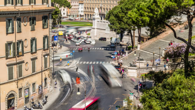 time lapse of the car traffic and people crowd near venice square (piazza venezia) and capitoline hill steps. rome, italy. april, 2016. - piazza venezia stock videos and b-roll footage