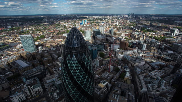 LONDON: Time Lapse of the city of London from the Cheesegrater roof top in a sunny and cloudy day