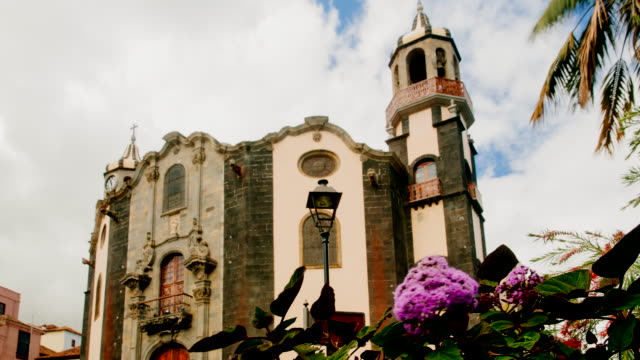 4K Time lapse of the Concepcion Cathedral and a flower with bees in La Orotava, Tenerife, Spain