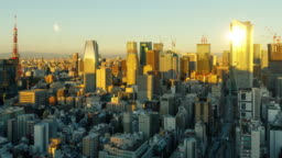 Time Lapse of the densely packs buildings of Tokyo Japan at sunrise