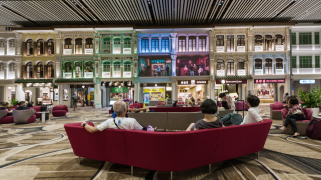 tl/ time lapse of the departure lounge at changi airport, commuters watching led display, showing traditional chinese culture - innovation stock videos & royalty-free footage