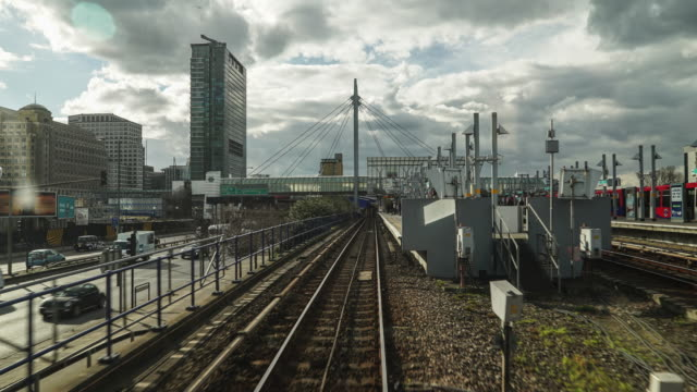 time lapse of the docklands light railway in london. - hyperlapse video stock e b–roll