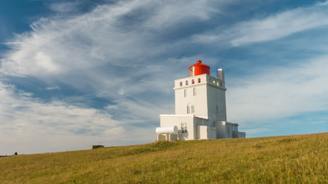 time lapse of the dyrholaey lighthouse in iceland - dyrholaey stock videos & royalty-free footage
