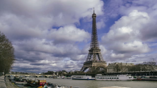 Time Lapse of the Eiffel Tower and river Seine under fast moving clouds.