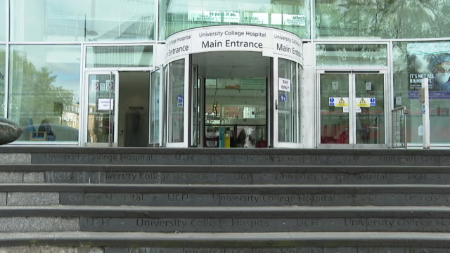 time lapse of the front entrance to university college hospital in london - steps stock videos & royalty-free footage