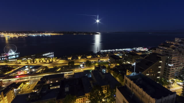 w/s time lapse of the full moonset at sunrise over elliot bay during the blue hour on august 10, 2014 (super moon) - filiz stock videos & royalty-free footage