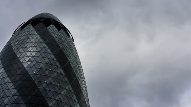 london - circa 2012: time lapse of the gherkin from the bottom with clouds and blue sky - swiss re stock videos & royalty-free footage