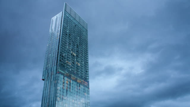 4k time lapse of the hilton hotel in manchester in a day to night transition - office block exterior stock videos & royalty-free footage