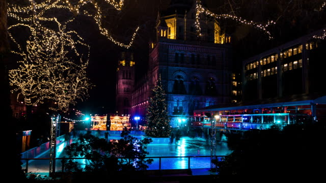 london circa 2012: time lapse of the ice rink in south kensington in front of the natural historic museum, in london - ice skating stock videos and b-roll footage