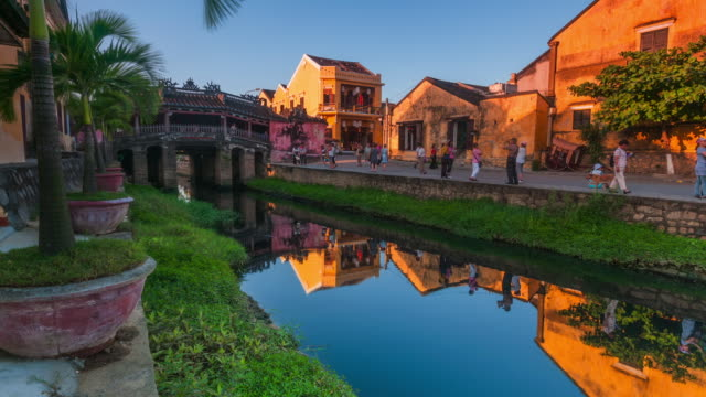 Time lapse of the Japanese bridge in Hoi An, Footage slowly zooms in to focus on the bridge. Hoi An, Vietnam, Asia