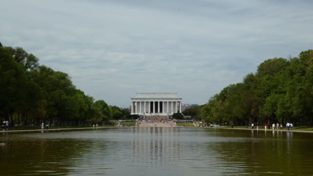 time lapse of the lincoln memorial across the refelection pool - unknown gender stock videos & royalty-free footage