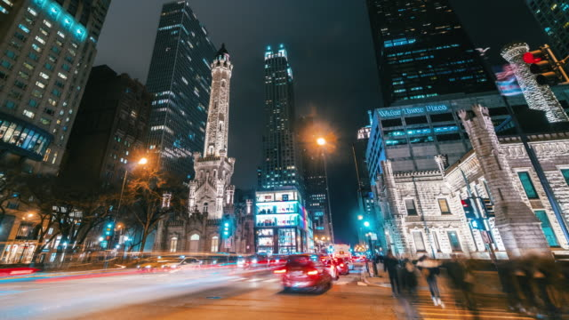 4k time lapse of the magnificent mile on north michigan avenue at nighttime in chicago, united states - michigan avenue chicago stock videos & royalty-free footage