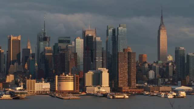 Time Lapse of the New York skyline.  The city goes from light to shade.