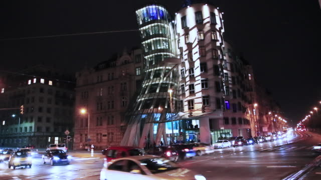 time lapse of the prague city at night with intersection and busy traffic in the dancing building a local landmark in prague. - prague stock videos & royalty-free footage