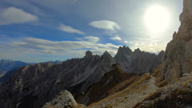 time lapse of the sharp dolomite mountains in the italian alps with footpath. - idyllic stock videos & royalty-free footage
