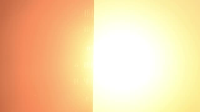 time lapse of the sitting-down sun in the city - bruciare video stock e b–roll