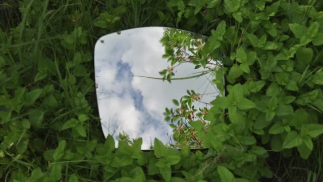 time lapse of the sky in mirror at nature background - mirror stock videos & royalty-free footage