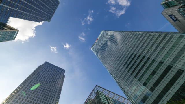 london: time lapse of the skyscrapers in canary wharf - canary wharf stock videos & royalty-free footage
