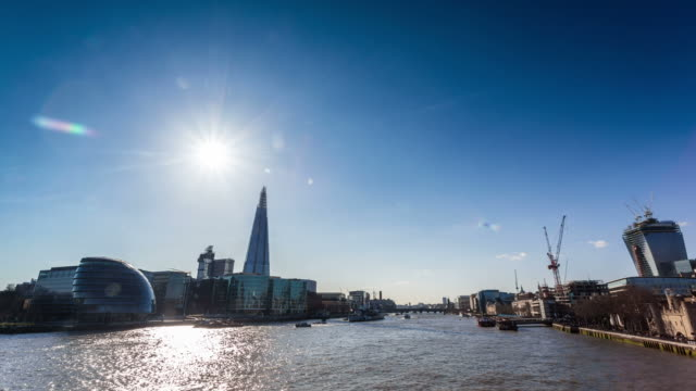 LONDON - CIRCA 2013: Time lapse of the Sun crossing behind The Shard with his shadow reflected into the Thames