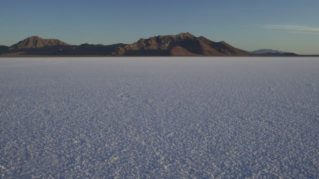 time lapse of the sunrise on the bonneville salt flats. - bonneville salt flats stock videos and b-roll footage