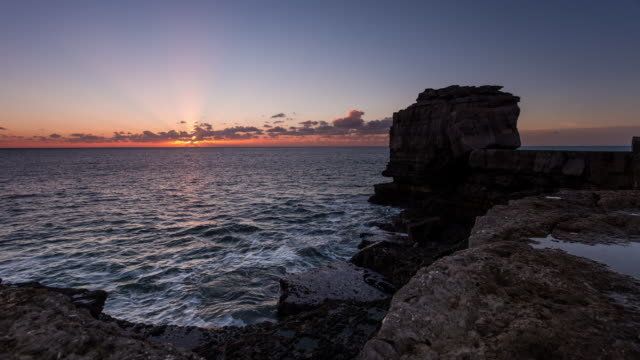 PORTLAND - CIRCA 2014: Time Lapse of the Sunset at the Pulpit Rock at the Jurassic Coast in Dorset