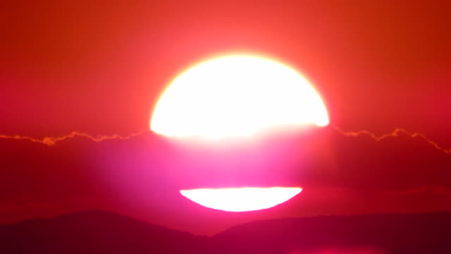 Time lapse of the Sunset with red sky and giant blazing sun n