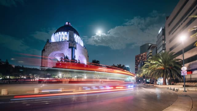 time lapse of the traffic circling revolution monument in mexico city - mexico city stock videos & royalty-free footage